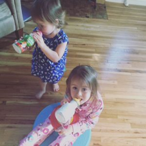 The girls drinking their superfood smoothie (Shakeology) that they BEGGED me for.