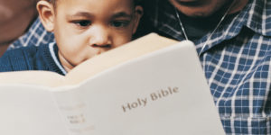 Grandfather and Grandson Reading Bible Together